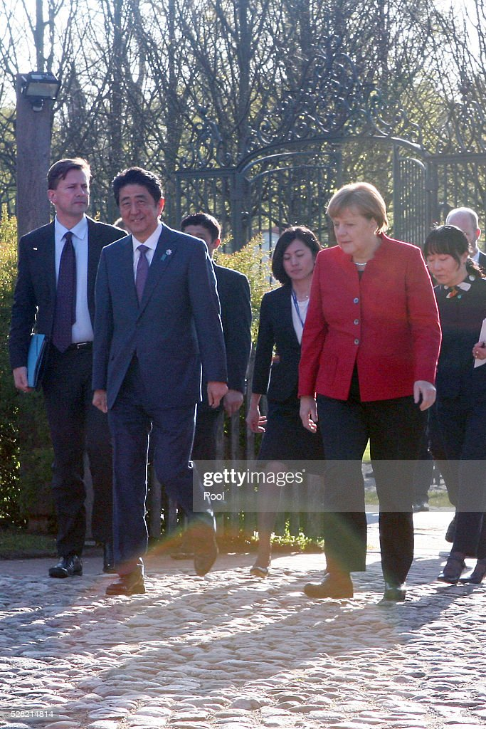 German Chancellor <a gi-track='captionPersonalityLinkClicked' href=/galleries/search?phrase=Angela+Merkel&family=editorial&specificpeople=202161 ng-click='$event.stopPropagation()'>Angela Merkel</a> and Japanese Prime Minister <a gi-track='captionPersonalityLinkClicked' href=/galleries/search?phrase=Shinzo+Abe&family=editorial&specificpeople=559017 ng-click='$event.stopPropagation()'>Shinzo Abe</a> at Schloss Meseberg palace on May 4, 2016 in Meseberg, Germany. The two leaders are meeting ahead of the upcoming G7 summit in Japan and also discussed both bilateral and international issues.