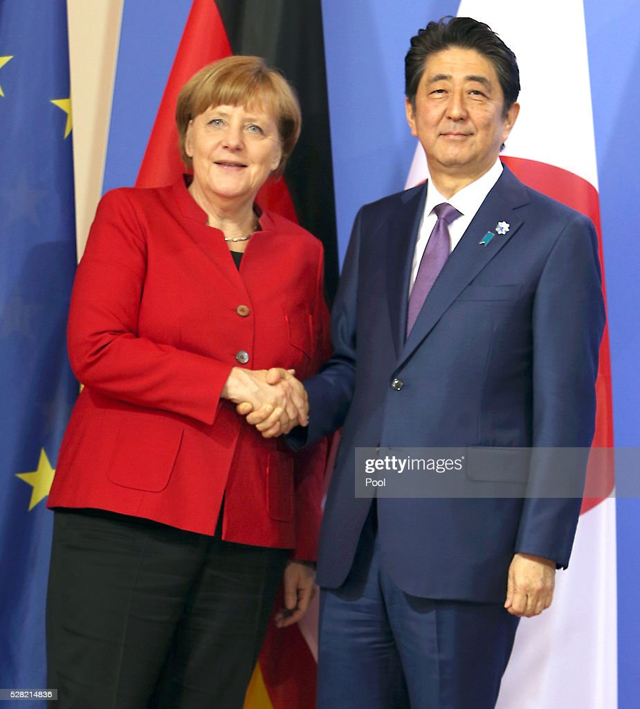 German Chancellor <a gi-track='captionPersonalityLinkClicked' href=/galleries/search?phrase=Angela+Merkel&family=editorial&specificpeople=202161 ng-click='$event.stopPropagation()'>Angela Merkel</a> and Japanese Prime Minister <a gi-track='captionPersonalityLinkClicked' href=/galleries/search?phrase=Shinzo+Abe&family=editorial&specificpeople=559017 ng-click='$event.stopPropagation()'>Shinzo Abe</a> shake hands during a joint press conference following talks at Schloss Meseberg palace on May 4, 2016 in Meseberg, Germany. The two leaders are meeting ahead of the upcoming G7 summit in Japan and also discussed both bilateral and international issues.