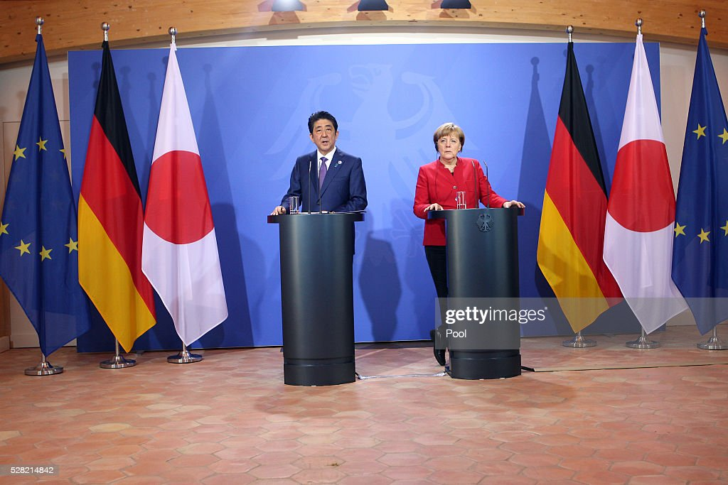 German Chancellor <a gi-track='captionPersonalityLinkClicked' href=/galleries/search?phrase=Angela+Merkel&family=editorial&specificpeople=202161 ng-click='$event.stopPropagation()'>Angela Merkel</a> and Japanese Prime Minister <a gi-track='captionPersonalityLinkClicked' href=/galleries/search?phrase=Shinzo+Abe&family=editorial&specificpeople=559017 ng-click='$event.stopPropagation()'>Shinzo Abe</a> speak to the media during a joint press conference following talks at Schloss Meseberg palace on May 4, 2016 in Meseberg, Germany. The two leaders are meeting ahead of the upcoming G7 summit in Japan and also discussed both bilateral and international issues.