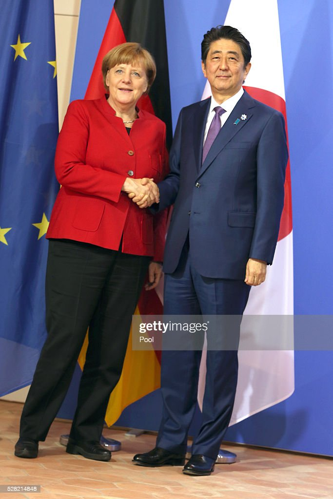 German Chancellor Angela Merkel and Japanese Prime Minister Shinzo Abe shake hands during a joint press conference following talks at Schloss Meseberg palace on May 4, 2016 in Meseberg, Germany. The two leaders are meeting ahead of the upcoming G7 summit in Japan and also discussed both bilateral and international issues.