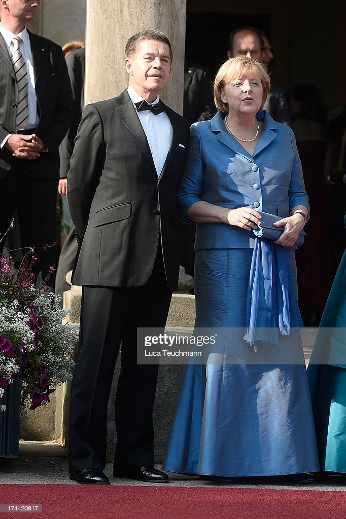 German Chancellor Angela Merkel and Joachim Sauer attend the Bayreuth Festival opening on July 25, 2013 in Bayreuth, Germany.