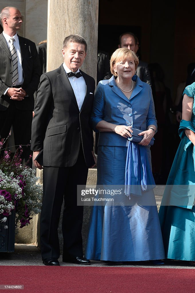 German Chancellor Angela Merkel and <a gi-track='captionPersonalityLinkClicked' href=/galleries/search?phrase=Joachim+Sauer&family=editorial&specificpeople=687595 ng-click='$event.stopPropagation()'>Joachim Sauer</a> attend the Bayreuth Festival opening on July 25, 2013 in Bayreuth, Germany.