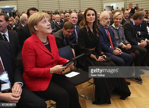 German Chancellor Angela Merkel and Jordanian Queen Rania of Jordan arrive at the annual congress of the Federation of German Industry at the annual...