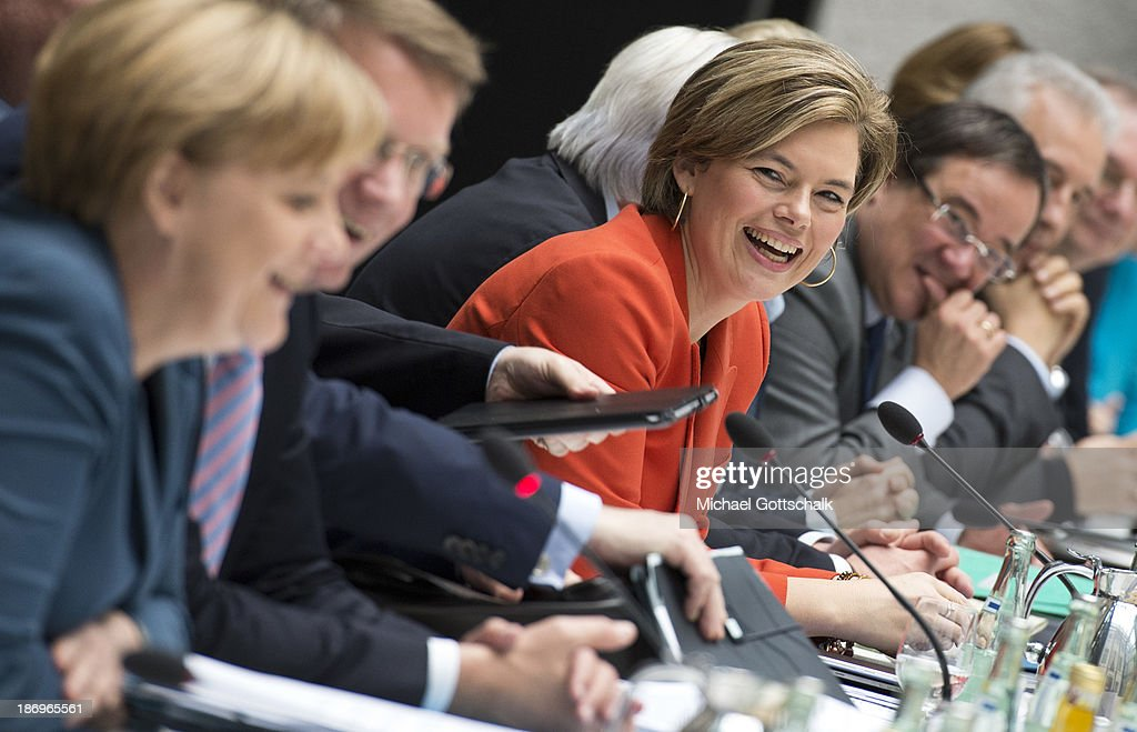German Chancellor <a gi-track='captionPersonalityLinkClicked' href=/galleries/search?phrase=Angela+Merkel&family=editorial&specificpeople=202161 ng-click='$event.stopPropagation()'>Angela Merkel</a> and <a gi-track='captionPersonalityLinkClicked' href=/galleries/search?phrase=Julia+Kloeckner&family=editorial&specificpeople=6902085 ng-click='$event.stopPropagation()'>Julia Kloeckner</a> (R), Head of CDU in German State of Rhineland-Palatinate, sit down during negotiations between the German Social Democrats (SPD), German Christian Democrats (CDU) and German Christian Social Democrats at the Bavarian state representation on November 5, 2013 in Berlin, Germany. The SPD, CSU and CDU are hashing through policy issues in an effort to create a new German colaition government following elections in September.