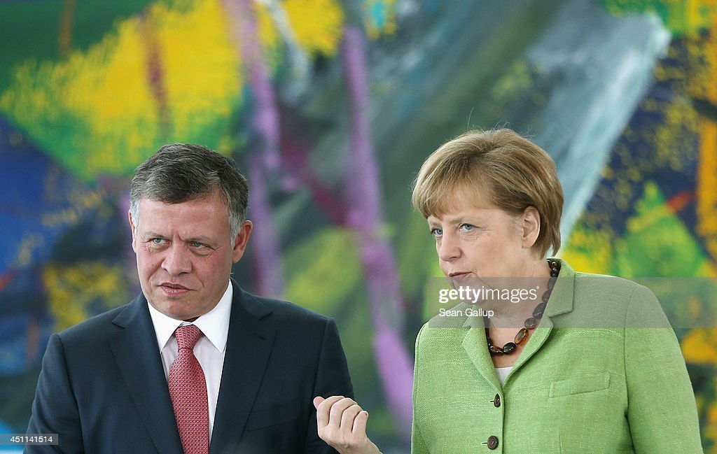 German Chancellor <a gi-track='captionPersonalityLinkClicked' href=/galleries/search?phrase=Angela+Merkel&family=editorial&specificpeople=202161 ng-click='$event.stopPropagation()'>Angela Merkel</a> and King <a gi-track='captionPersonalityLinkClicked' href=/galleries/search?phrase=Abdullah+II&family=editorial&specificpeople=171586 ng-click='$event.stopPropagation()'>Abdullah II</a> of Jordan arrive to give statements to the media prior to talks at the Chancellery on June 24, 2014 in Berlin, Germany. The two leaders meeting amidst reports of continued consilidation of territory in Iraq, including border posts to Jordan, by ISIS Sunni fighteres in Iraq.