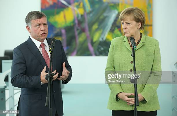 German Chancellor Angela Merkel and King Abdullah II of Jordan give statements to the media prior to talks at the Chancellery on June 24 2014 in...