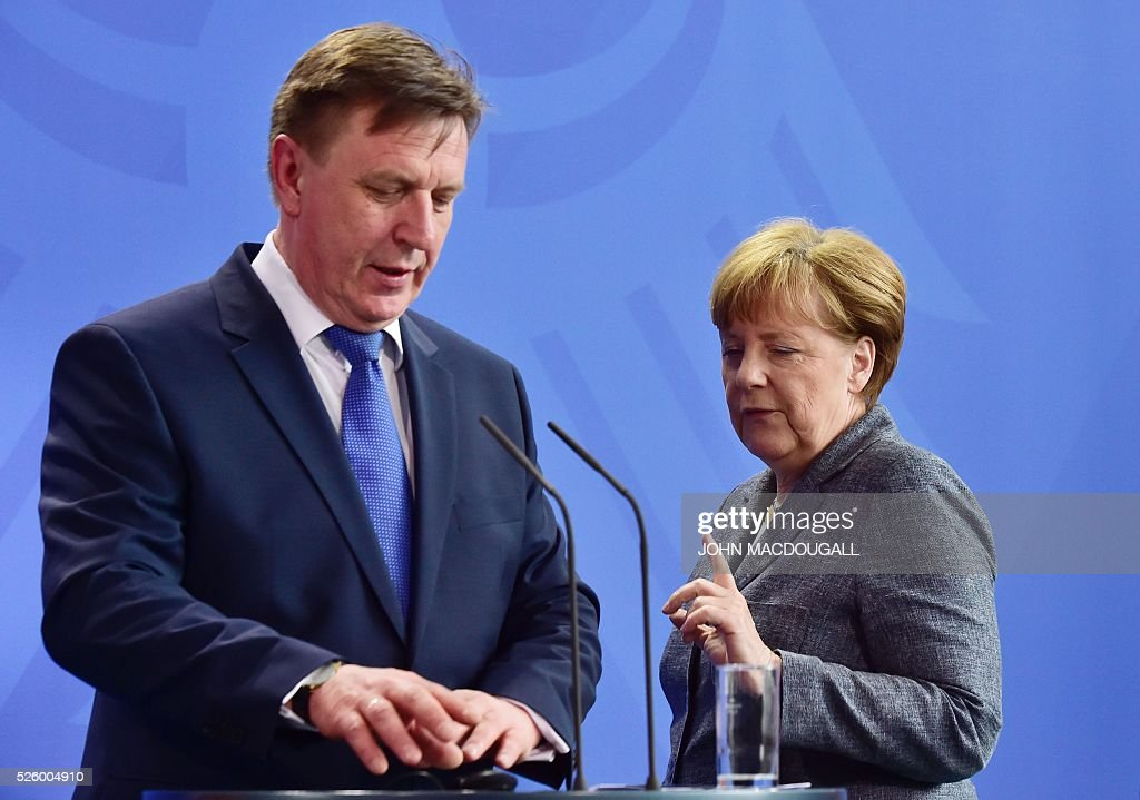 German Chancellor Angela Merkel (R) and Latvian Prime Minister Maris Kucinskis arrive for a joint press conference in Berlin, on April 29, 2016. / AFP / John MACDOUGALL