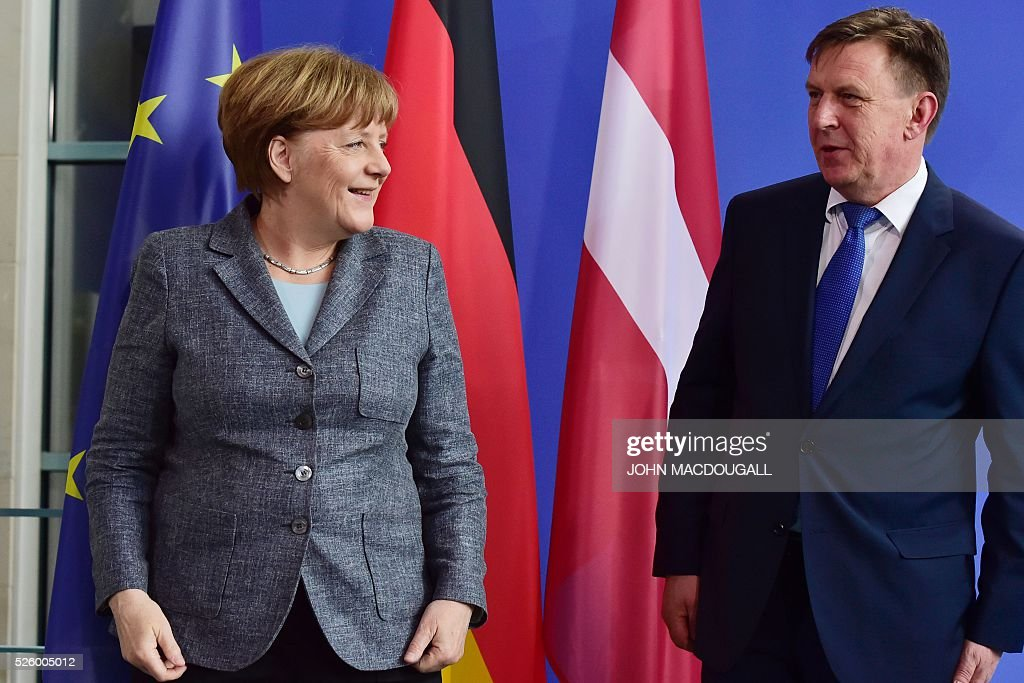 German Chancellor Angela Merkel (L) and Latvian Prime Minister Maris Kucinskis leave after a joint press conference in Berlin, on April 29, 2016. / AFP / John MACDOUGALL