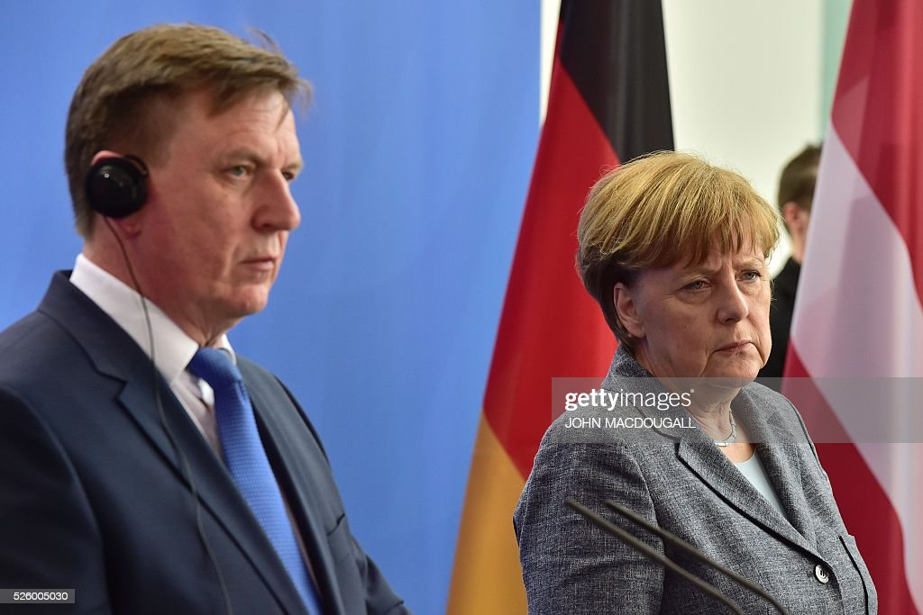 German Chancellor Angela Merkel (R) and Latvian Prime Minister Maris Kucinskis attend a joint press conference in Berlin, on April 29, 2016. / AFP / John MACDOUGALL