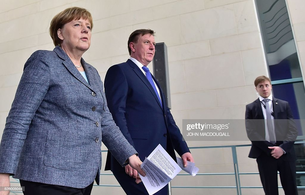 German Chancellor Angela Merkel (L) and Latvian Prime Minister Maris Kucinskis arrive for a joint press conference in Berlin, on April 29, 2016. / AFP / John MACDOUGALL