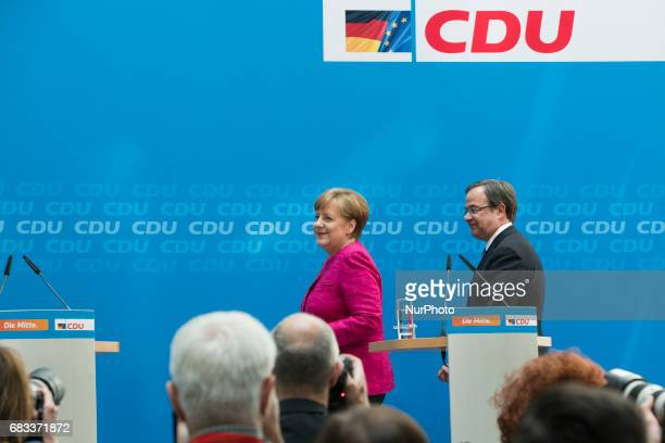 German Chancellor Angela Merkel and lead candidate of the Christian Democratic Union in North RhineWestphalia state elections Armin Laschet arrive to...