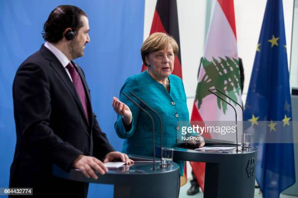 German Chancellor Angela Merkel and Lebanese Prime Minister Saad Hariri address a statement to the media before a lunch meeting in Berlin Germany on...