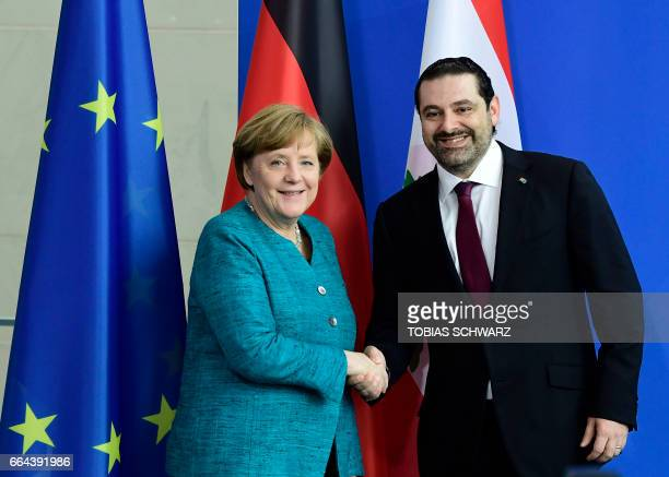 German Chancellor Angela Merkel and Lebanese Prime Minister Saad Hariri shake hands after a statement to the media before a meeting in Berlin April 4...