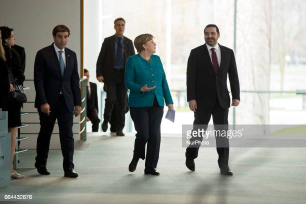 German Chancellor Angela Merkel and Lebanese Prime Minister Saad Hariri arrive to address a statement to the media in Berlin Germany on April 4 2017