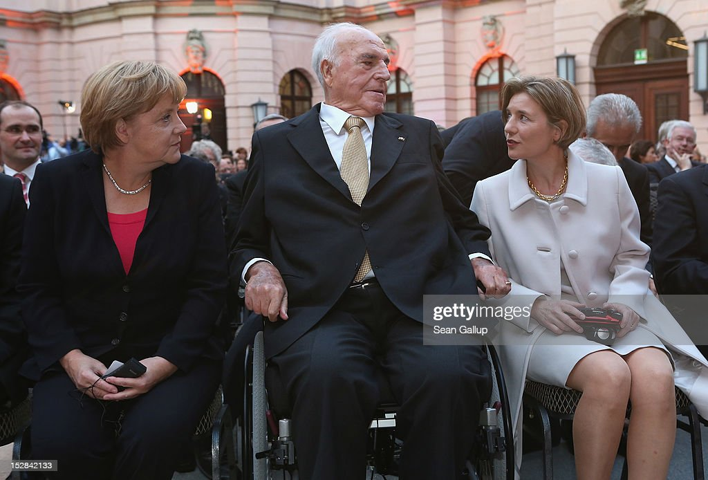 German Chancellor Angela Merkel and Maike KohlRichter chat with former German Chancellor Helmut Kohl upon their arrival at a gala evening in Kohl's...