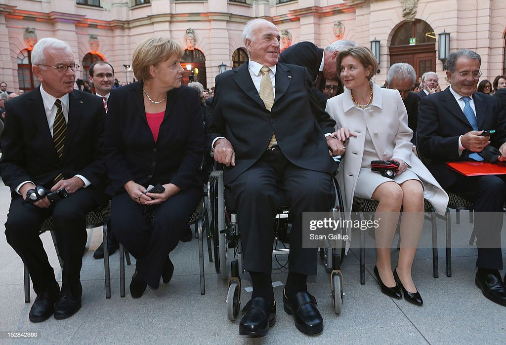 German Chancellor Angela Merkel (C-L) and <a gi-track='captionPersonalityLinkClicked' href=/galleries/search?phrase=Maike+Kohl-Richter&family=editorial&specificpeople=5847197 ng-click='$event.stopPropagation()'>Maike Kohl-Richter</a> (C-R) chat with former German Chancellor <a gi-track='captionPersonalityLinkClicked' href=/galleries/search?phrase=Helmut+Kohl&family=editorial&specificpeople=202518 ng-click='$event.stopPropagation()'>Helmut Kohl</a> (C) as former Italian Prime Minister <a gi-track='captionPersonalityLinkClicked' href=/galleries/search?phrase=Romano+Prodi&family=editorial&specificpeople=203301 ng-click='$event.stopPropagation()'>Romano Prodi</a> (R) and European Parliament President Hans-Gert Pottering (L) look on upon their arrival at a gala evening in Kohl's honour at the Deutsches Museum on September 27, 2012 in Berlin, Germany. Guests from politics, church and society attended the event to honour Kohl on the 30th anniversary of Kohl becoming chancellor. During his chancellorship Kohl facillitated the end of the Cold War, the fall of the Berlin Wall and German reunification.
