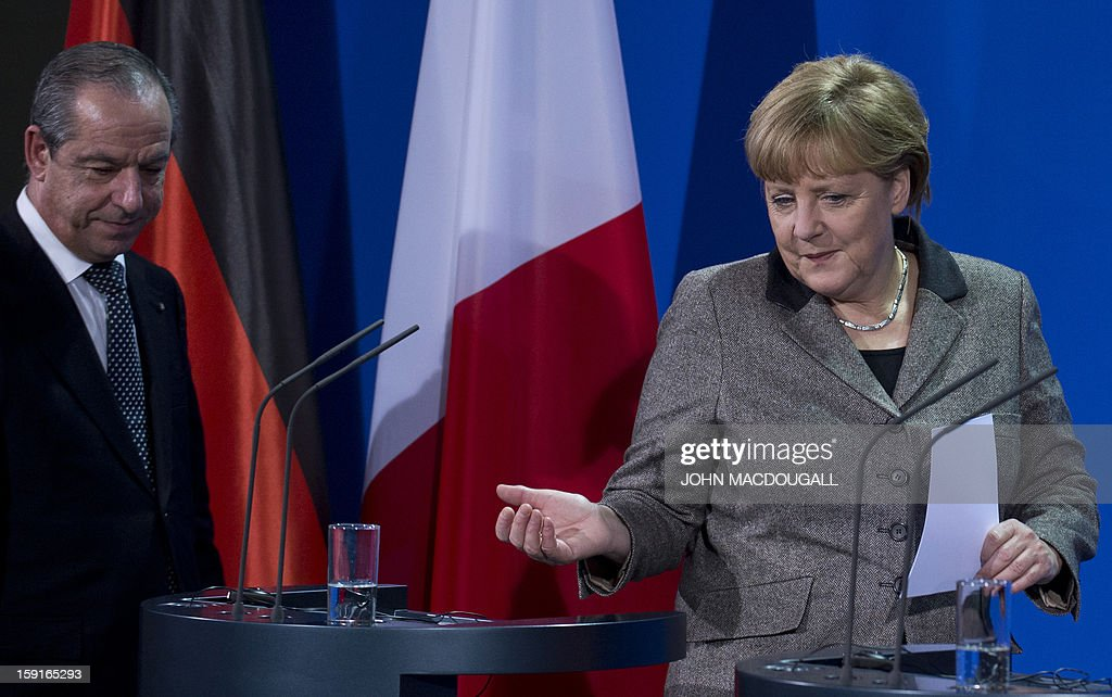 German Chancellor Angela Merkel (R) and Malta's Prime Minister Lawrence Gonzi (L) arrive for a press conference following talks at the chancellery in Berlin, Germany on January 9, 2013.