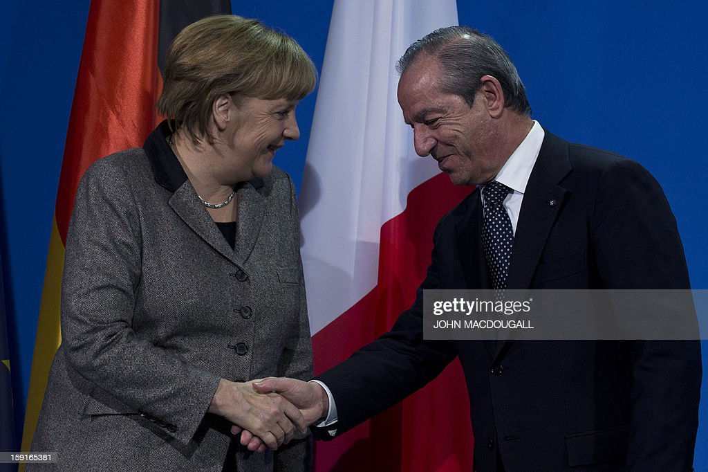 German Chancellor Angela Merkel (L) and Malta's Prime Minister Lawrence Gonzi (R) shake hands after addressing a press conference at the chancellery in Berlin, Germany on January 9, 2013.