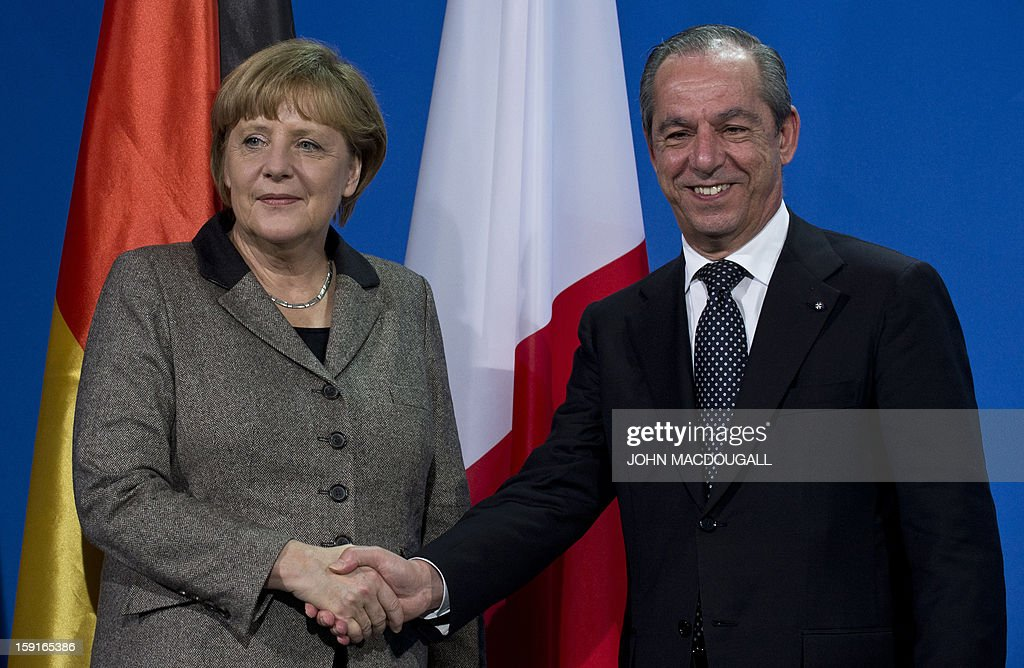 German Chancellor Angela Merkel (L) and Malta's Prime Minister Lawrence Gonzi (R) shake hands after addressing a press conference at the chancellery in Berlin, Germany on January 9, 2013. AFP PHOTO / JOHN MACDOUGALL