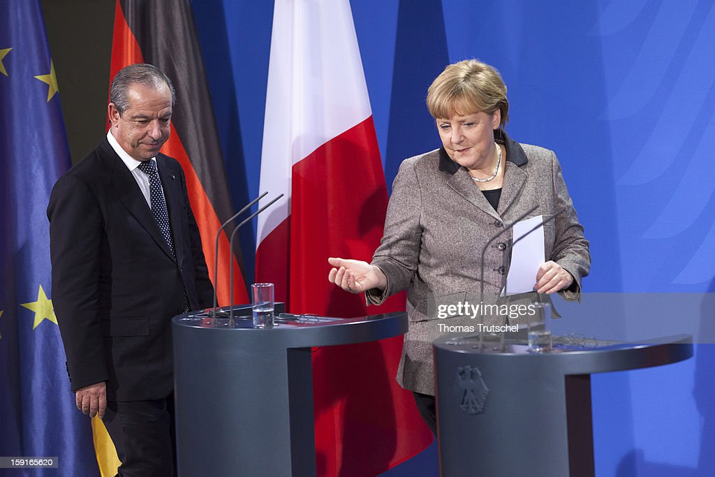 German Chancellor Angela Merkel, and Malta's Prime Minister <a gi-track='captionPersonalityLinkClicked' href=/galleries/search?phrase=Lawrence+Gonzi&family=editorial&specificpeople=568017 ng-click='$event.stopPropagation()'>Lawrence Gonzi</a> arrive for a press conference at Chancellery (Bundeskanzleramt) on January 9, 2013 in Berlin, Germany.
