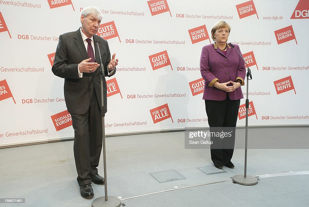 German Chancellor <a gi-track='captionPersonalityLinkClicked' href=/galleries/search?phrase=Angela+Merkel&family=editorial&specificpeople=202161 ng-click='$event.stopPropagation()'>Angela Merkel</a> and <a gi-track='captionPersonalityLinkClicked' href=/galleries/search?phrase=Michael+Sommer&family=editorial&specificpeople=228298 ng-click='$event.stopPropagation()'>Michael Sommer</a>, head of the German Federation of Labour Unions (DGB), speak to the media after talks on January 15, 2013 in Berlin, Germany. The two met to discuss policy issues ahead of German federal elections scheduled for later this year.