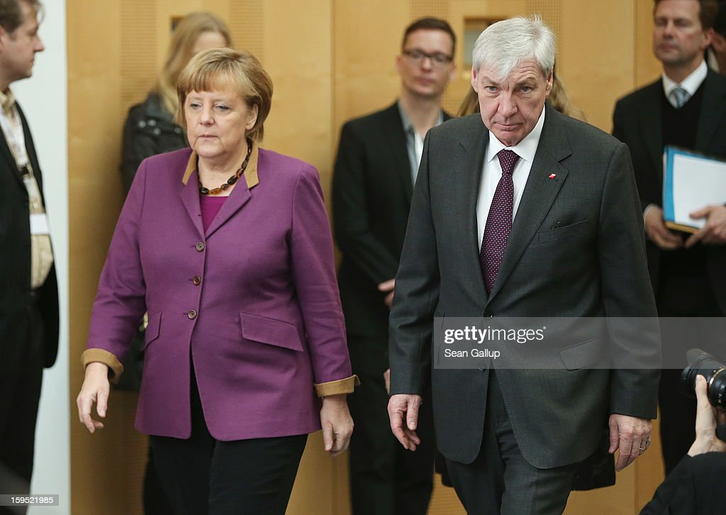 German Chancellor <a gi-track='captionPersonalityLinkClicked' href=/galleries/search?phrase=Angela+Merkel&family=editorial&specificpeople=202161 ng-click='$event.stopPropagation()'>Angela Merkel</a> and <a gi-track='captionPersonalityLinkClicked' href=/galleries/search?phrase=Michael+Sommer&family=editorial&specificpeople=228298 ng-click='$event.stopPropagation()'>Michael Sommer</a>, head of the German Federation of Labour Unions (DGB), arrive to speak to the media after talks on January 15, 2013 in Berlin, Germany. The two met to discuss policy issues ahead of German federal elections scheduled for later this year.