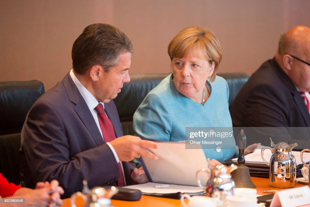 German Chancellor Angela Merkel (L) and Minister of Foreign Affairs Sigmar Gabriel are seen during the opening of the weekly government cabinet meeting on August 16, 2017 in Berlin, Germany. Today is the first cabinet meeting since government members were on summer vacation. Germany faces federal elections in September.