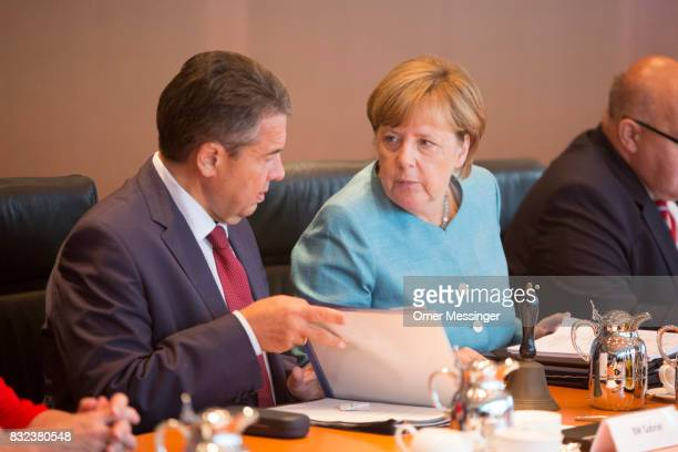 German Chancellor Angela Merkel and Minister of Foreign Affairs Sigmar Gabriel are seen during the opening of the weekly government cabinet meeting...