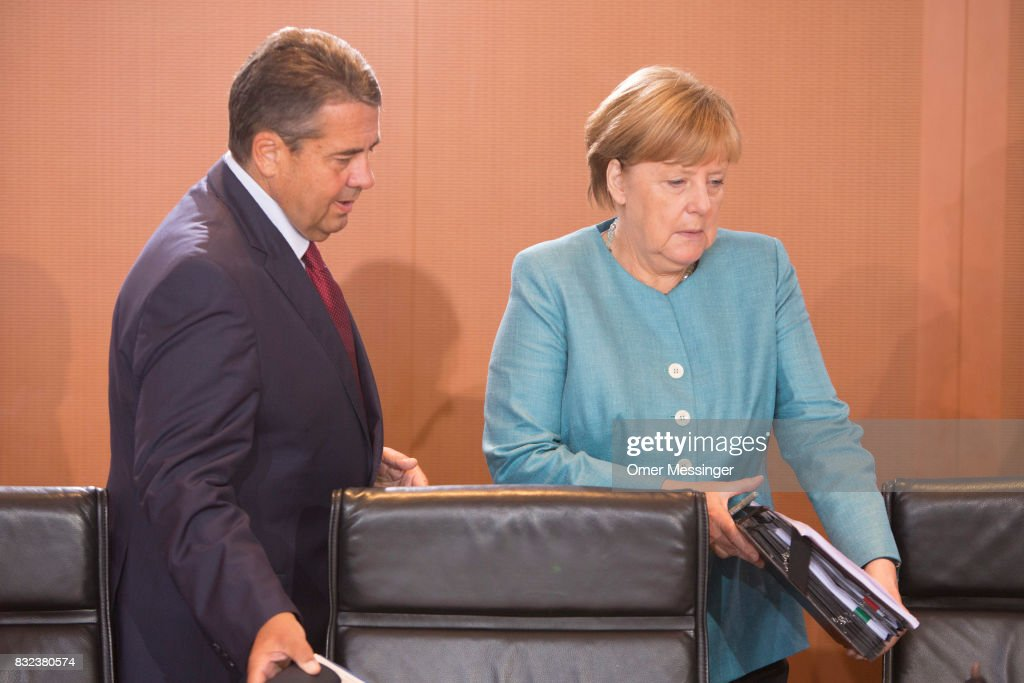 German Chancellor Angela Merkel (R) and Minister of Foreign Affairs Sigmar Gabriel are seen arriving for the weekly government cabinet meeting on August 16, 2017 in Berlin, Germany. Today is the first cabinet meeting since government members return from summer vacation. Germany faces federal elections in September.