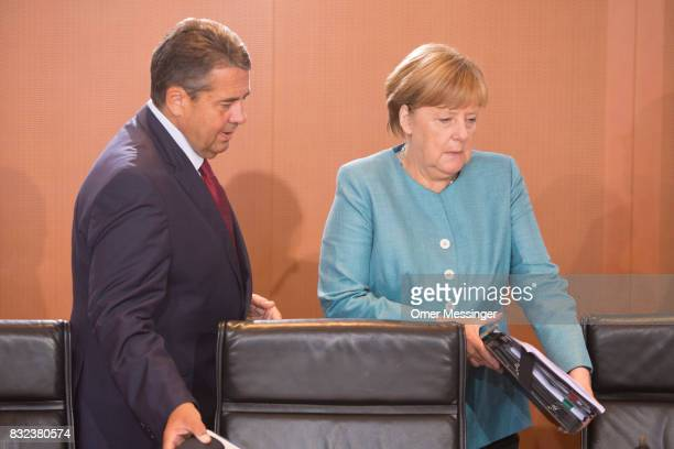 German Chancellor Angela Merkel and Minister of Foreign Affairs Sigmar Gabriel are seen arriving for the weekly government cabinet meeting on August...