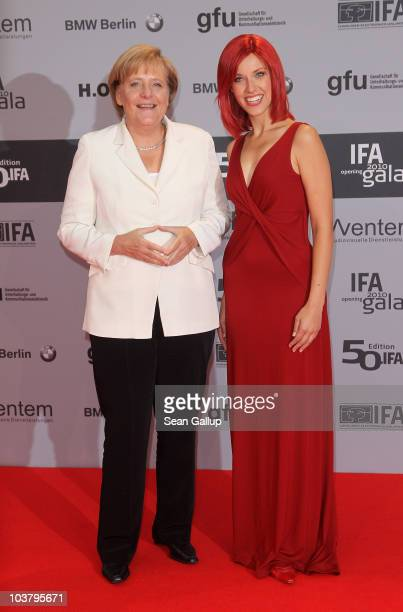 German Chancellor Angela Merkel and Miss IFA attend the IFA Opening Ceremony at the Palais am Funkturm on September 2 2010 in Berlin Germany
