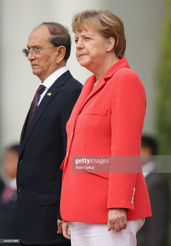 German Chancellor <a gi-track='captionPersonalityLinkClicked' href=/galleries/search?phrase=Angela+Merkel&family=editorial&specificpeople=202161 ng-click='$event.stopPropagation()'>Angela Merkel</a> and Myanmar President <a gi-track='captionPersonalityLinkClicked' href=/galleries/search?phrase=Thein+Sein&family=editorial&specificpeople=787536 ng-click='$event.stopPropagation()'>Thein Sein</a> review a guard of honour upon <a gi-track='captionPersonalityLinkClicked' href=/galleries/search?phrase=Thein+Sein&family=editorial&specificpeople=787536 ng-click='$event.stopPropagation()'>Thein Sein</a>'s arrival at the Chancellery on September 3, 2014 in Berlin, Germany. President <a gi-track='captionPersonalityLinkClicked' href=/galleries/search?phrase=Thein+Sein&family=editorial&specificpeople=787536 ng-click='$event.stopPropagation()'>Thein Sein</a> is on a two-day visit to Germany, during which he will also meet with German President Gauck and Bundestag President Lammert.