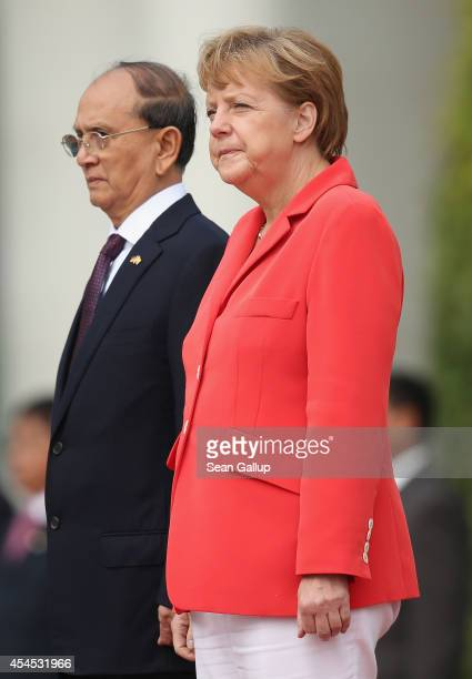German Chancellor Angela Merkel and Myanmar President Thein Sein review a guard of honour upon Thein Sein's arrival at the Chancellery on September 3...