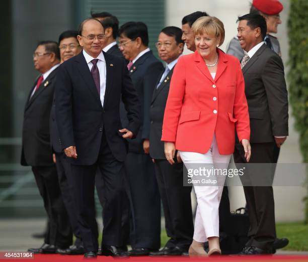 German Chancellor Angela Merkel and Myanmar President Thein Sein chat upon Thein Sein's arrival at the Chancellery on September 3 2014 in Berlin...