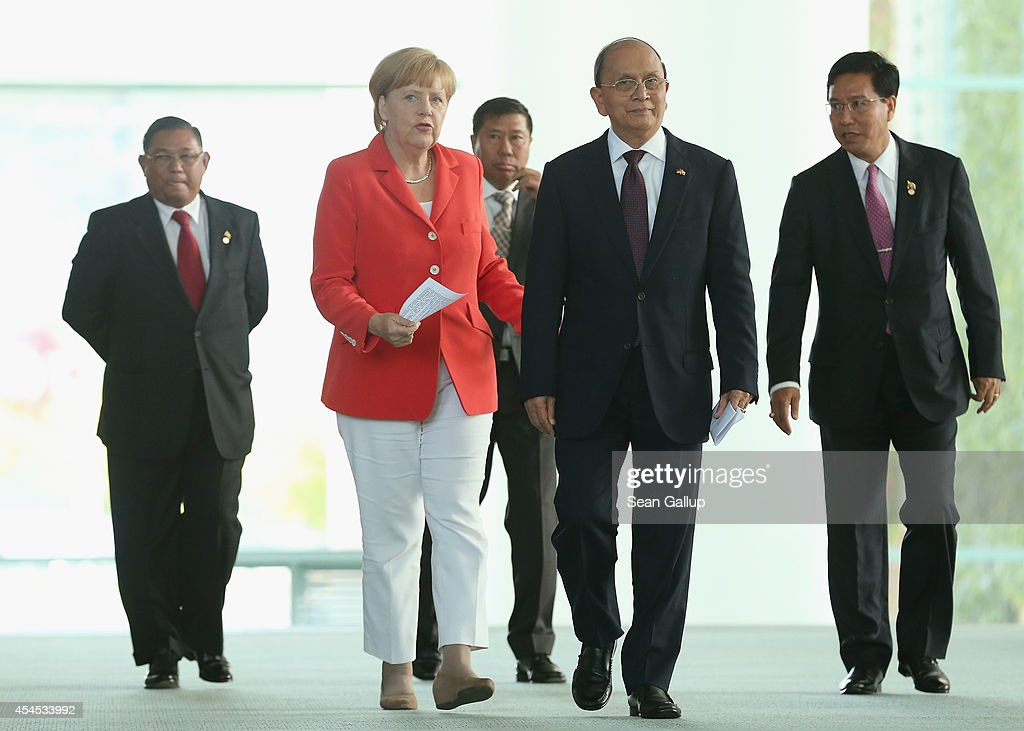 German Chancellor <a gi-track='captionPersonalityLinkClicked' href=/galleries/search?phrase=Angela+Merkel&family=editorial&specificpeople=202161 ng-click='$event.stopPropagation()'>Angela Merkel</a> and Myanmar President <a gi-track='captionPersonalityLinkClicked' href=/galleries/search?phrase=Thein+Sein&family=editorial&specificpeople=787536 ng-click='$event.stopPropagation()'>Thein Sein</a> (C-R) arrive to speak to the media following bilateral talks at the Chancellery on September 3, 2014 in Berlin, Germany. President <a gi-track='captionPersonalityLinkClicked' href=/galleries/search?phrase=Thein+Sein&family=editorial&specificpeople=787536 ng-click='$event.stopPropagation()'>Thein Sein</a> is on a two-day visit to Germany, during which he will also meet with German President Gauck and Bundestag President Lammert.