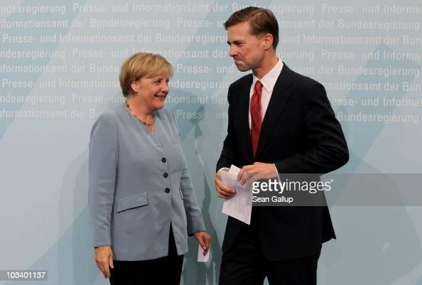 German Chancellor Angela Merkel and new German government spokesman Steffen Seibert arrive at Seibert's official presentation as new spokesman at the...
