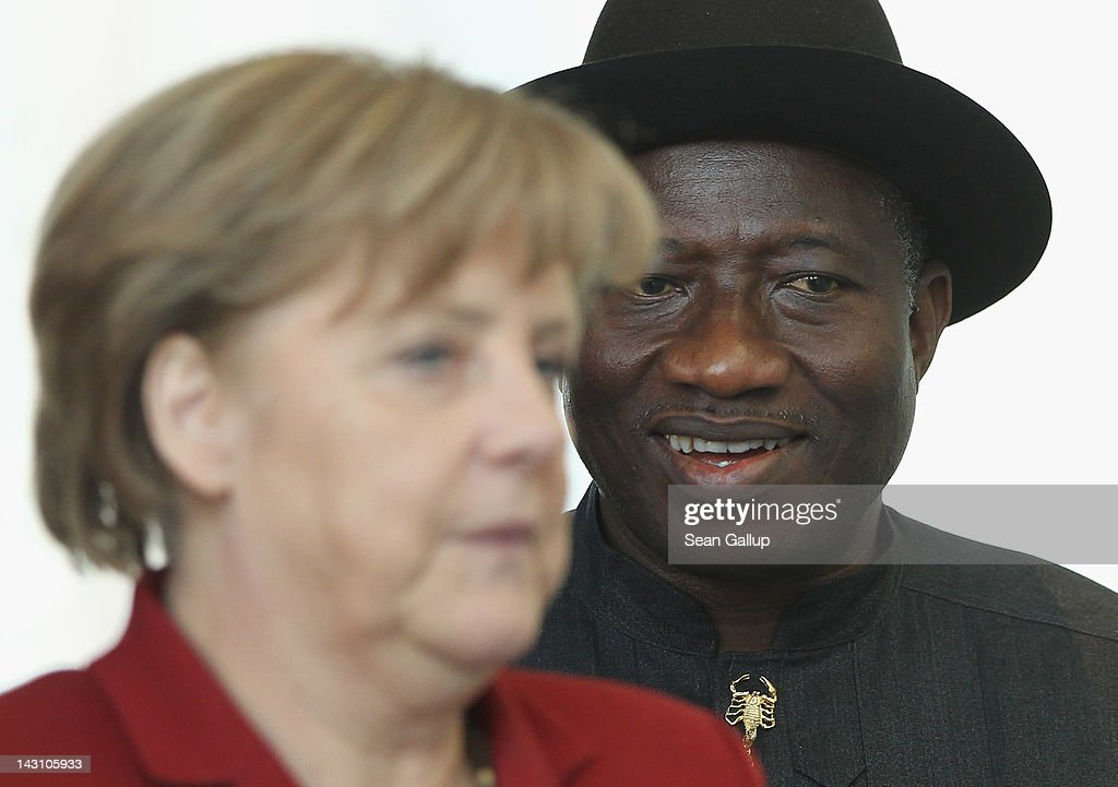 German Chancellor <a gi-track='captionPersonalityLinkClicked' href=/galleries/search?phrase=Angela+Merkel&family=editorial&specificpeople=202161 ng-click='$event.stopPropagation()'>Angela Merkel</a> and Nigerian President <a gi-track='captionPersonalityLinkClicked' href=/galleries/search?phrase=Goodluck+Jonathan&family=editorial&specificpeople=4124968 ng-click='$event.stopPropagation()'>Goodluck Jonathan</a> arrive to speak to the media following talks at the Chancellery on April 19, 2012 in Berlin, Germany. The two leaders discussed economic cooperation between their two countries as well as security issues.