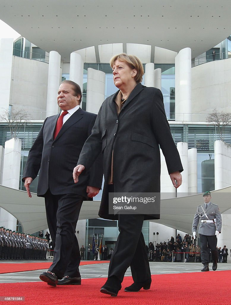 German Chancellor <a gi-track='captionPersonalityLinkClicked' href=/galleries/search?phrase=Angela+Merkel&family=editorial&specificpeople=202161 ng-click='$event.stopPropagation()'>Angela Merkel</a> and Pakistani Prime Minister <a gi-track='captionPersonalityLinkClicked' href=/galleries/search?phrase=Nawaz+Sharif&family=editorial&specificpeople=217726 ng-click='$event.stopPropagation()'>Nawaz Sharif</a> review a guard of honour upon Sharif's arrival at the Chancellery on November 11, 2014 in Berlin, Germany. Sharif is on a two-day official visit to Germany.