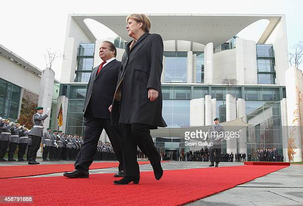 German Chancellor Angela Merkel and Pakistani Prime Minister Nawaz Sharif review a guard of honour upon Sharif's arrival at the Chancellery on...