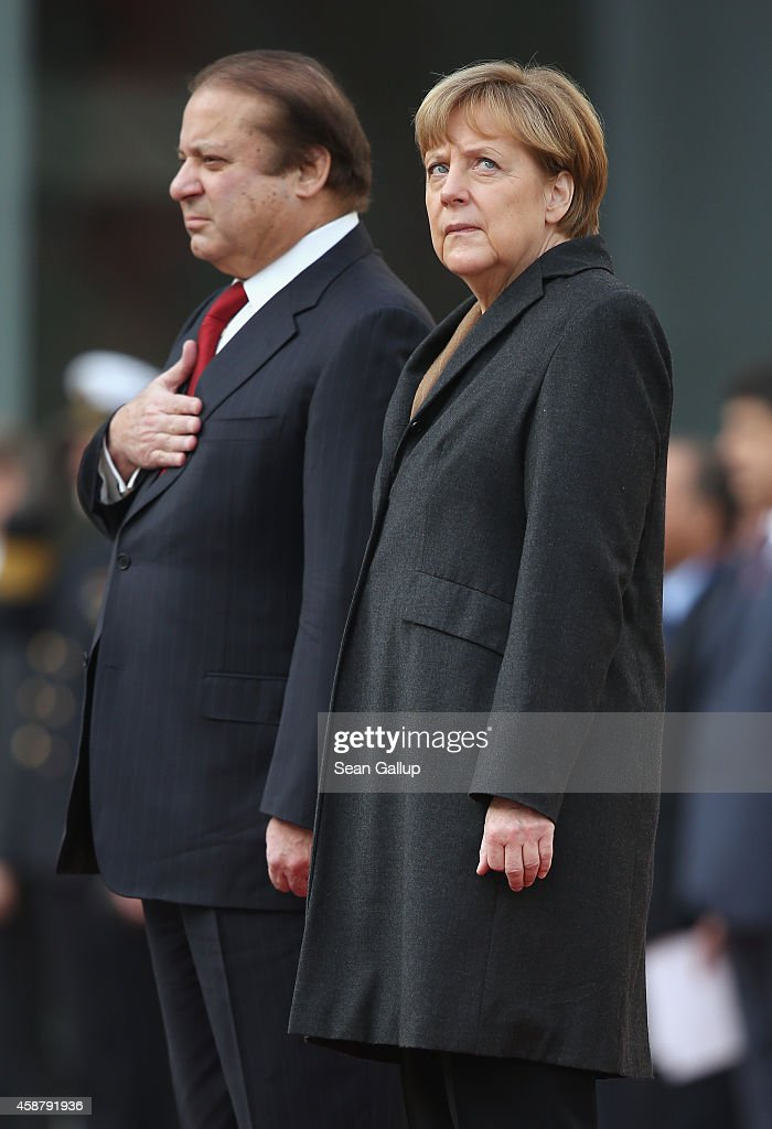 German Chancellor <a gi-track='captionPersonalityLinkClicked' href=/galleries/search?phrase=Angela+Merkel&family=editorial&specificpeople=202161 ng-click='$event.stopPropagation()'>Angela Merkel</a> and Pakistani Prime Minister <a gi-track='captionPersonalityLinkClicked' href=/galleries/search?phrase=Nawaz+Sharif&family=editorial&specificpeople=217726 ng-click='$event.stopPropagation()'>Nawaz Sharif</a> listen to their countries' respective national anthems upon Sharif's arrival at the Chancellery on November 11, 2014 in Berlin, Germany. Sharif is on a two-day official visit to Germany.