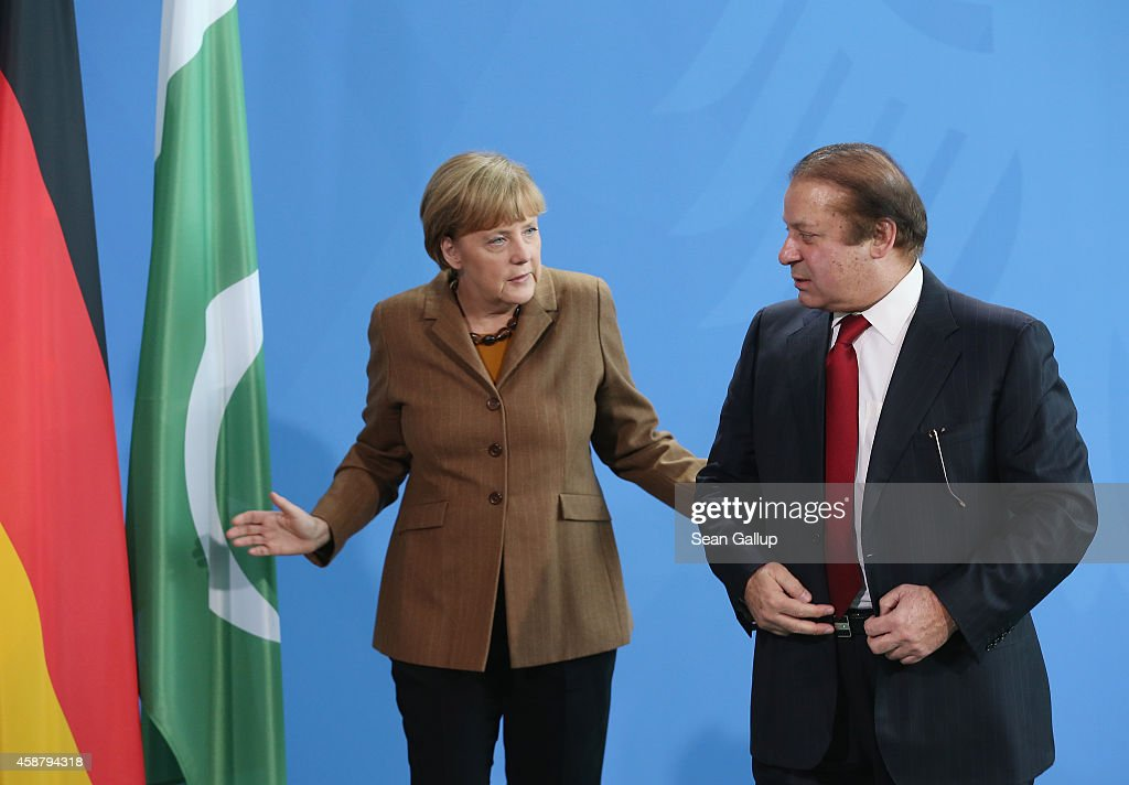 German Chancellor <a gi-track='captionPersonalityLinkClicked' href=/galleries/search?phrase=Angela+Merkel&family=editorial&specificpeople=202161 ng-click='$event.stopPropagation()'>Angela Merkel</a> and Pakistani Prime Minister <a gi-track='captionPersonalityLinkClicked' href=/galleries/search?phrase=Nawaz+Sharif&family=editorial&specificpeople=217726 ng-click='$event.stopPropagation()'>Nawaz Sharif</a> depart after speaking to the media following talks at the Chancellery on November 11, 2014 in Berlin, Germany. Sharif is on a two-day official visit to Germany.