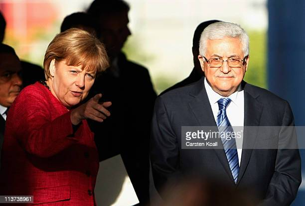 German Chancellor Angela Merkel and Palestinian Authority President Mahmoud Abbas arrive for a press conference at the Chancellery on May 5 2011 in...