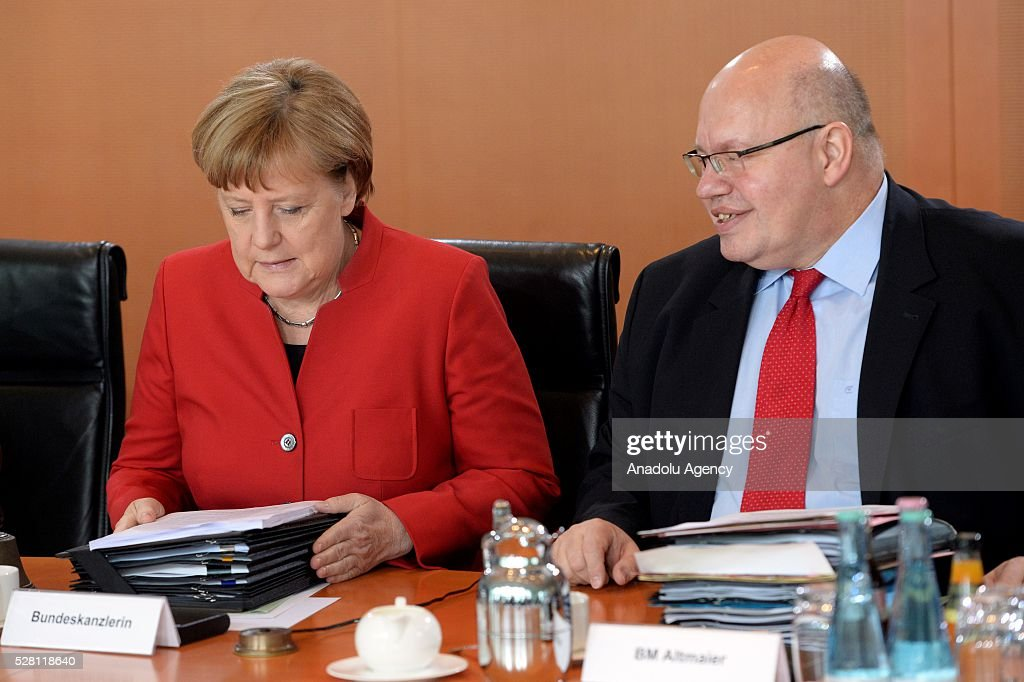 German Chancellor Angela Merkel (L) and Peter Altmeier, Head of the German Federal Chancellery (R) attend the weekly cabinet meeting at the Chancellery in Berlin, Germany on May 04, 2016.