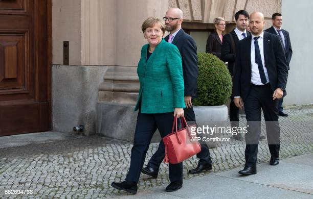 German Chancellor Angela Merkel and Peter Tauber secretary general of her conservative Christian Democratic Union arrive for exploratory talks with...