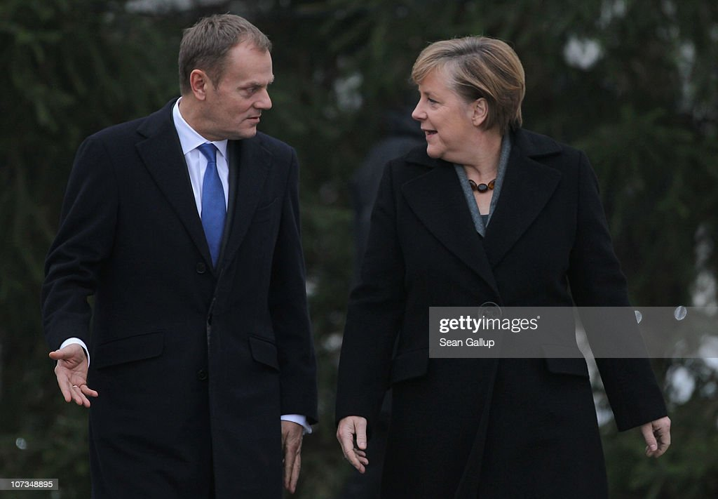German Chancellor <a gi-track='captionPersonalityLinkClicked' href=/galleries/search?phrase=Angela+Merkel&family=editorial&specificpeople=202161 ng-click='$event.stopPropagation()'>Angela Merkel</a> and Poland's Prime Minister <a gi-track='captionPersonalityLinkClicked' href=/galleries/search?phrase=Donald+Tusk&family=editorial&specificpeople=870281 ng-click='$event.stopPropagation()'>Donald Tusk</a> chat upon Tusk's arrival at the Chancellery (Bundeskanzleramt) on December 6, 2010 in Berlin, Germany. Tusk and Merkel are meeting for the ninth German-Polish government consultations ahead of an upcoming meeting of European Union member state delegates in Brussels.