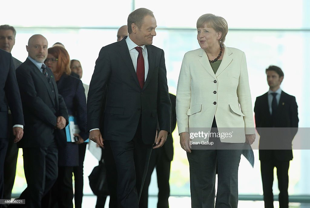 German Chancellor <a gi-track='captionPersonalityLinkClicked' href=/galleries/search?phrase=Angela+Merkel&family=editorial&specificpeople=202161 ng-click='$event.stopPropagation()'>Angela Merkel</a> and Polish President <a gi-track='captionPersonalityLinkClicked' href=/galleries/search?phrase=Donald+Tusk&family=editorial&specificpeople=870281 ng-click='$event.stopPropagation()'>Donald Tusk</a> arrive to give statements to the media upon Tusk's arrival at the Chancellery on April 25, 2014 in Berlin, Germany. Tusk and Merkel are meeting to discuss the situation in eastern Ukraine as diplomats scramble to ease tensions between Ukraine and Russia.