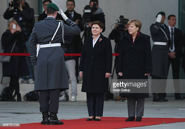 German Chancellor Angela Merkel and Polish Prime Minister Beata Szydlo finish reviewing a guard of honor upon Szydlo's arrival at the Chancellery on...