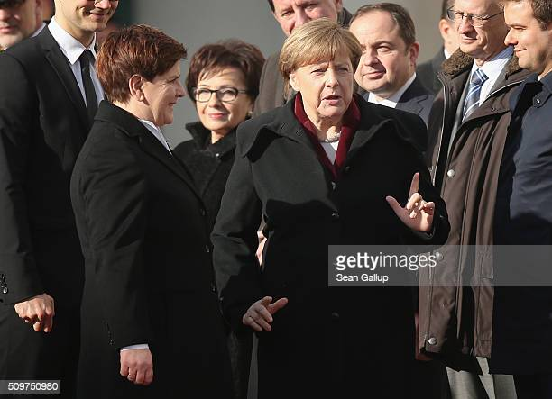 German Chancellor Angela Merkel and Polish Prime Minister Beata Szydlo chat upon Szydlo's arrival at the Chancellery on February 12 2016 in Berlin...