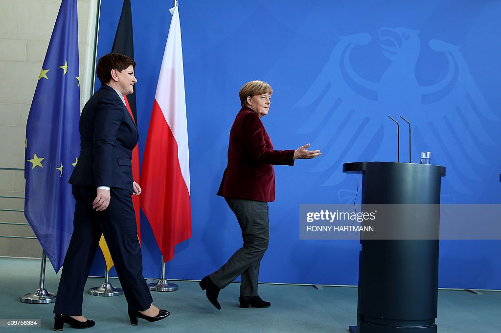 German Chancellor Angela Merkel (R) and Polish Prime Minister Beata Szydlo arrive for a press statement at the Chancellery in Berlin on February 12, 2016. / AFP / Ronny Hartmann