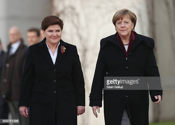 German Chancellor Angela Merkel and Polish Prime Minister Beata Szydlo prepare to review a guard of honor upon Szydlo's arrival at the Chancellery on...